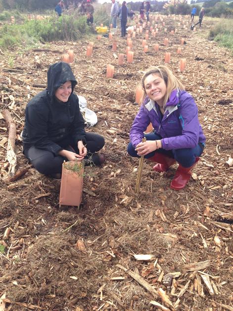 Volunteers Jess Massey and Sam Feeney showing off their planting skills with Hawksbury Lagoon.