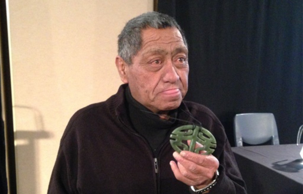 Ben Hutana showing his taonga to a conference journalist.