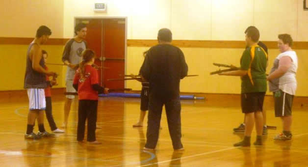 Waiariki Parata-Taiapa warms the group up at a mau taiaha training session at Waikouaiti Events Centre.