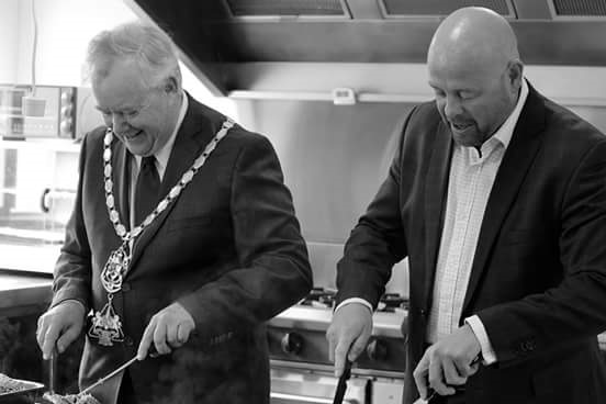 Waimate Mayor, Craig Rowley and Timaru Mayor, Damon Odey carving the meat for lunch.