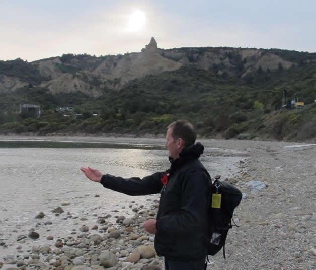 Wayne Costello casting the aotea and waitai into the Aegean Sea at North Beach, Gallipoli.
