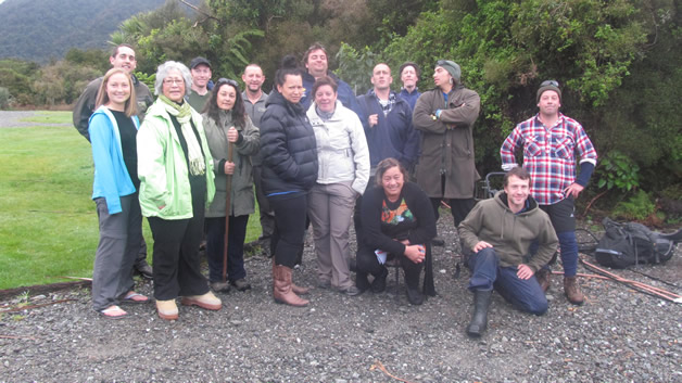 Whānau and staff gather outside Hollyford Lodge on their final day.