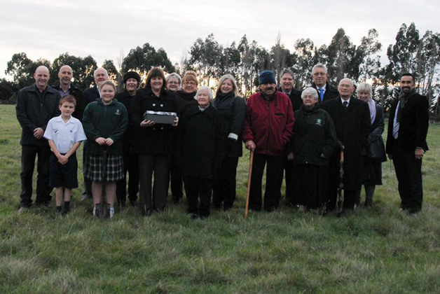 Whānau gather for a picture at the site of the soil blessing.