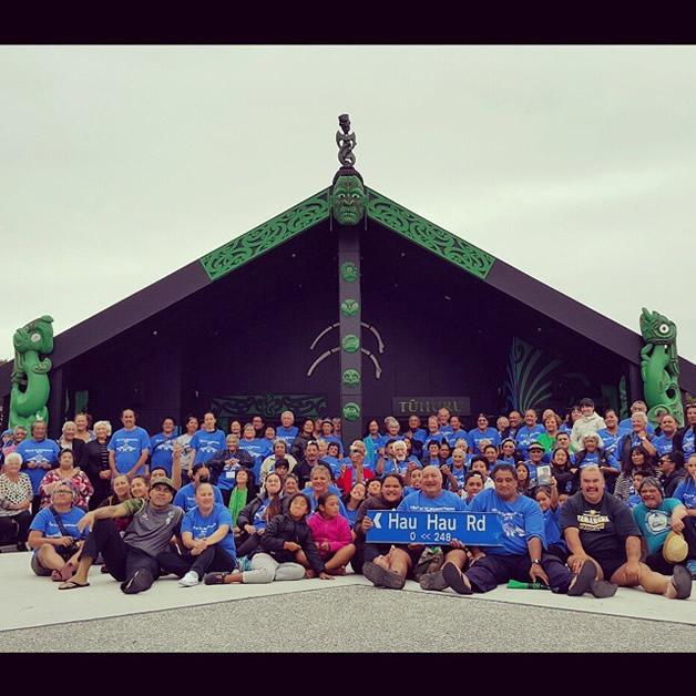 Ngāti Waewae and Ngāruahine whānau gather in front of Tūhuru Marae.