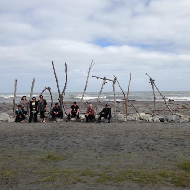 Whānau in front of the iconic Hokitika Beach sign. From left, Gail Thomspn, Ana Beaton, Kate Eruera, Joanne Pera, Thomas Aerepo-Morgan, Anthony Fowler, Louise Fowler and Bubba Thompson.