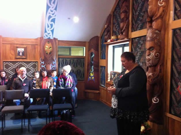 Whānau member Helen Rasmussen reads the Scripture.