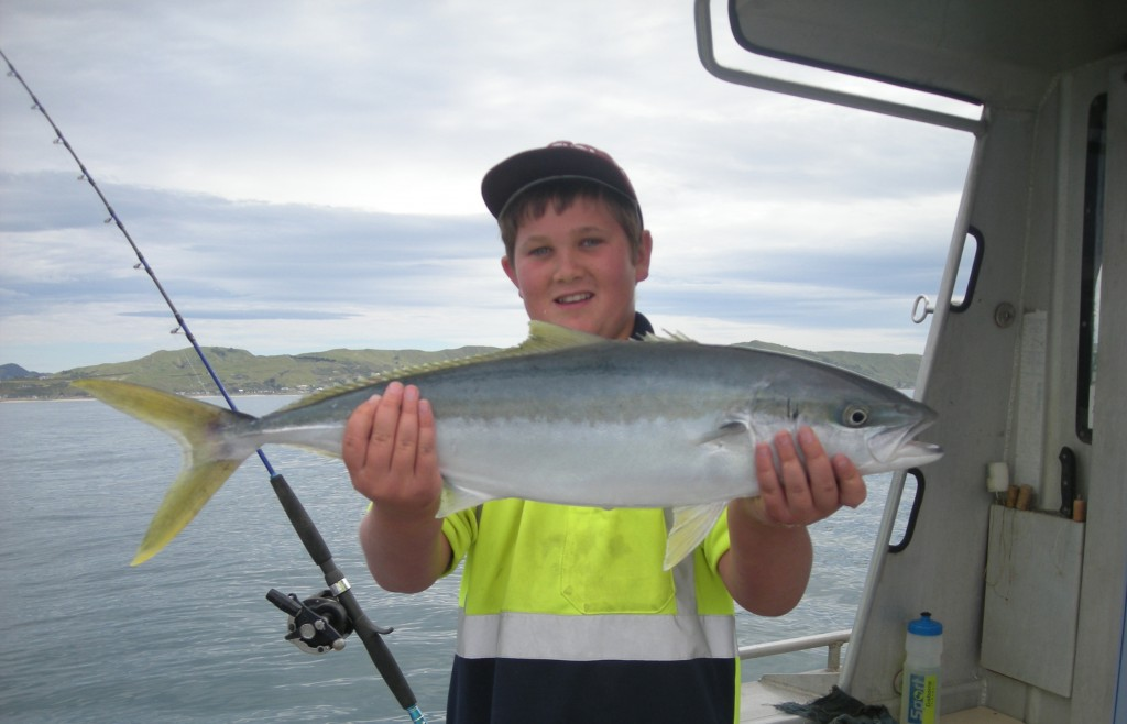 Angelo with a Kingfish he caught last summer on Tairawhiti Harbour.