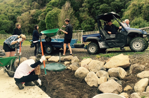 The rōpū completing some landscaping around the marae.